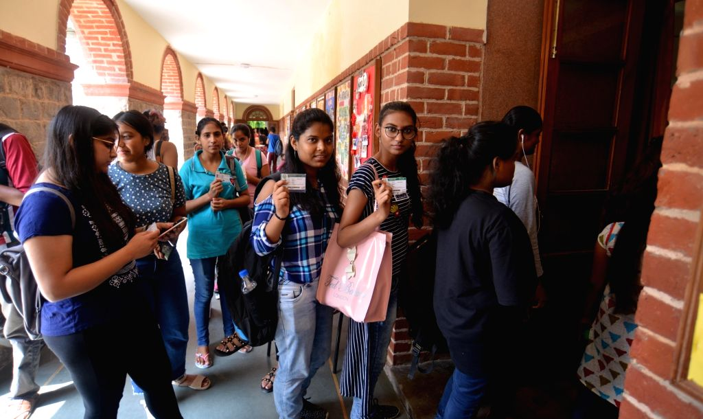 Students queue up to cast their votes during Delhi University Students' Union (DUSU) election in New Delhi on Sept 12, 2018.