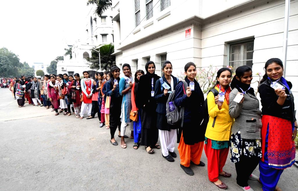 Students queue up to cast their votes for the Patna University Students Union elections, on Dec 7, 2019.