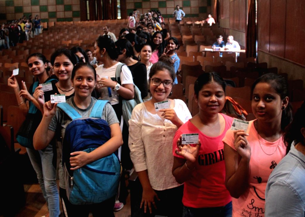 Students queue up with their identity cards to cast their votes for the Delhi University Students Union (DUSU) elections, at Miranda House College in North Campus, in New Delhi on Sep 12, ...