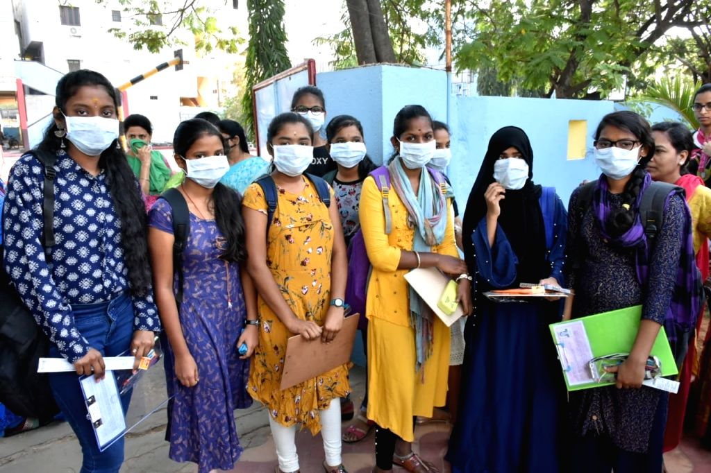 Students reach outside their respective examination centres wearing masks amid COVID-19, in Hyderabad on March 19,2020.