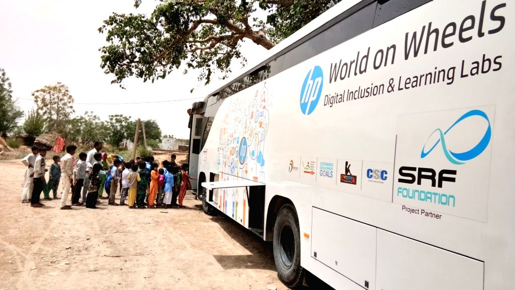 """Students ready to board """"HP World on Wheels"""" (WoW), buses that are already driving digital literacy in rural India."""