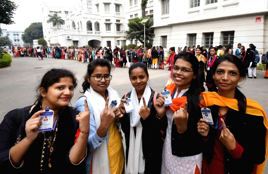 Students show their inked fingers after casting votes for Patna University Students Union elections, on Dec 7, 2019.