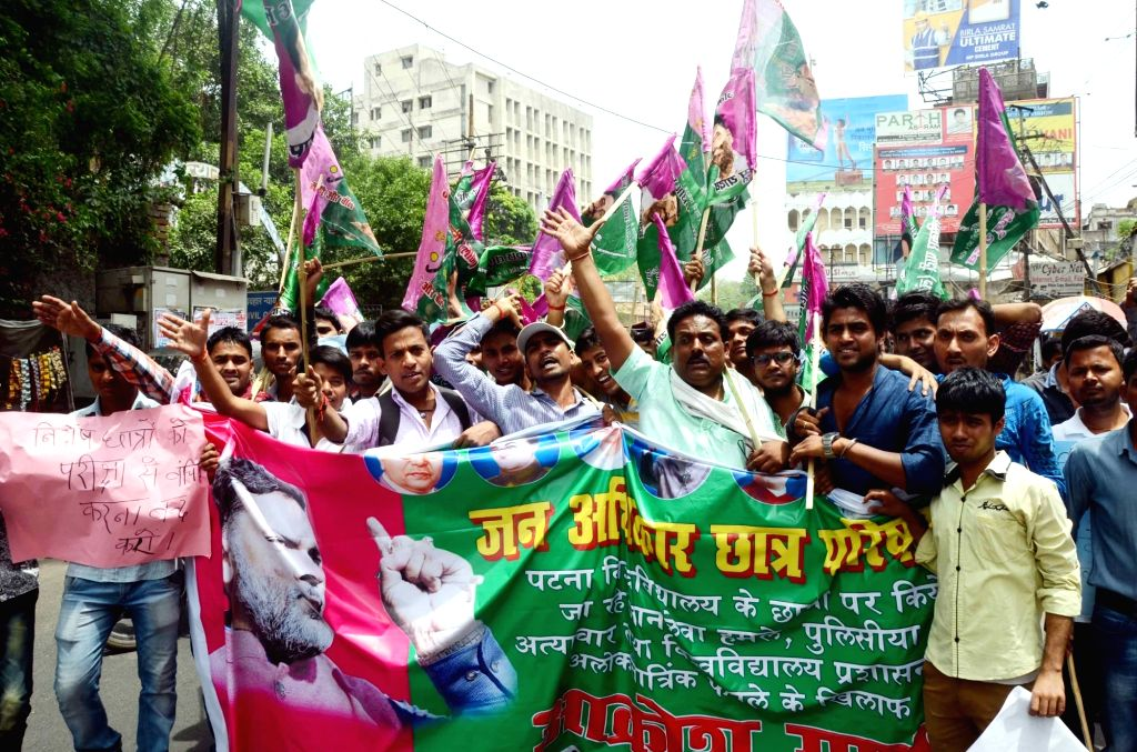 Students stage a demonstration against attack on Patna University students in Patna, on April 20, 2016.