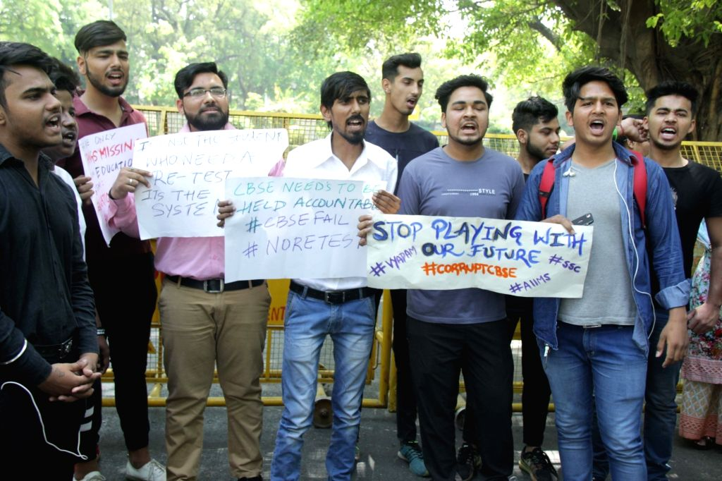 Students stage a demonstration against re-examination after the leak of Class X Maths and Class XII Economics papers, at Parliament Street in New Delhi on March 29, 2018.