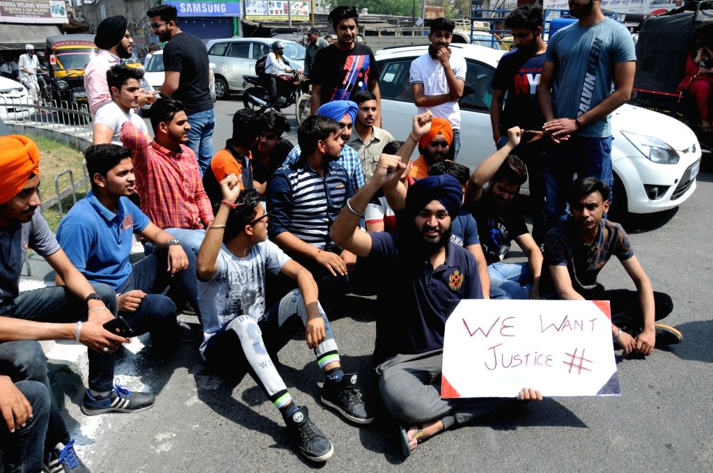 Students stage a demonstration against re-examination after the leak of CBSE Class X Maths and Class XII Economics papers, in Amritsar on March 31, 2018.