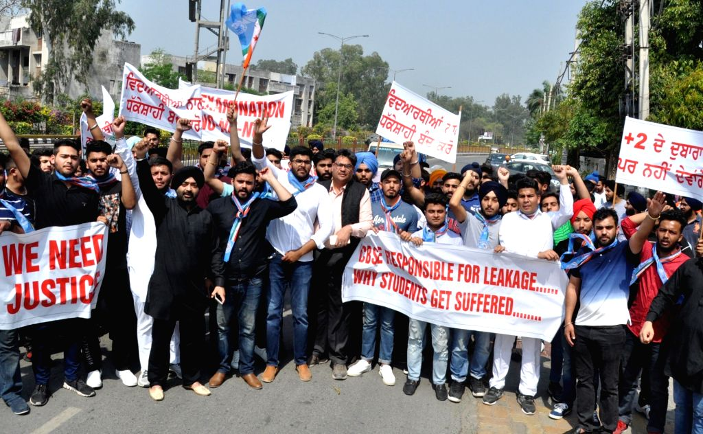 Students stage a demonstration against re-examination after the leak of CBSE Class X Maths and Class XII Economics papers, in Amritsar on April 1, 2018.
