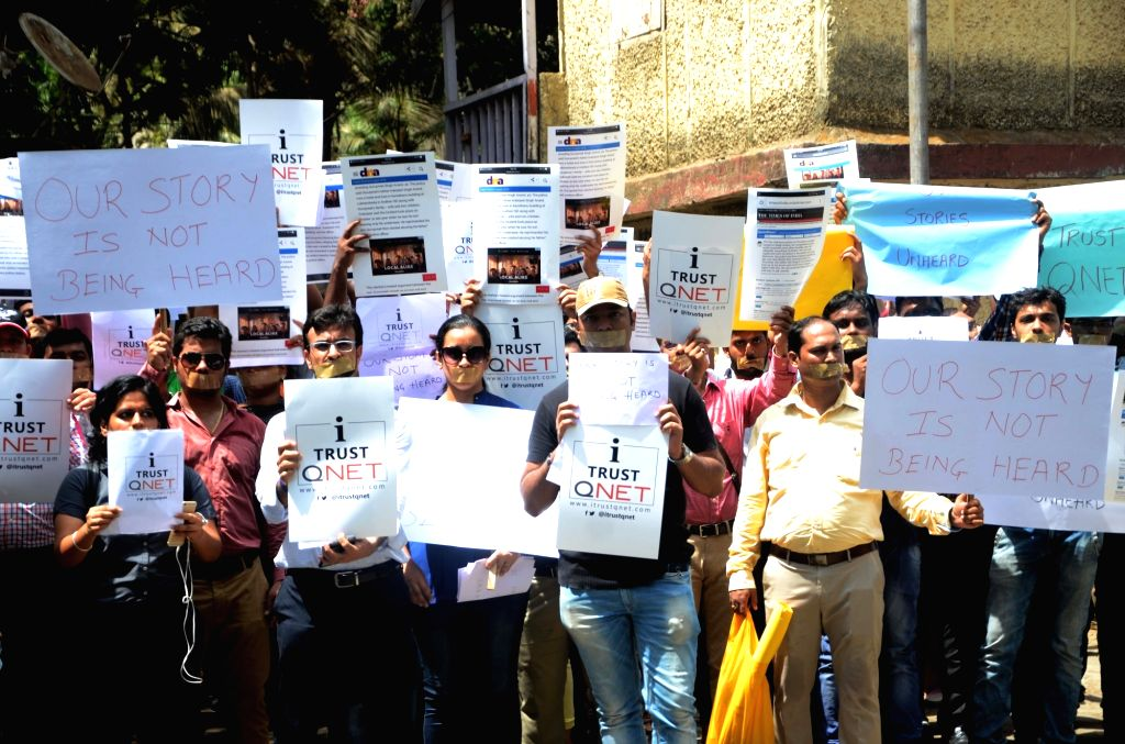 Students stage a demonstration against the QNet multi-level marketing (MLM) scam in Mumbai, on May 18, 2016.