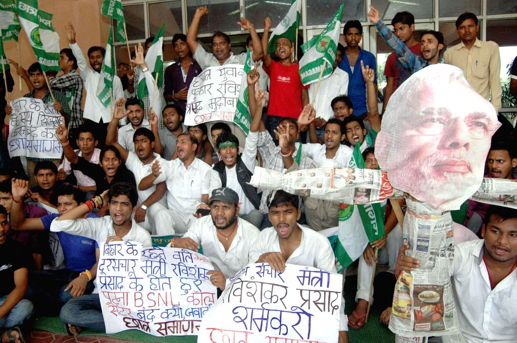 Students stage a demonstration in front of BSNL office in in Patna on Aug 28, 2014.