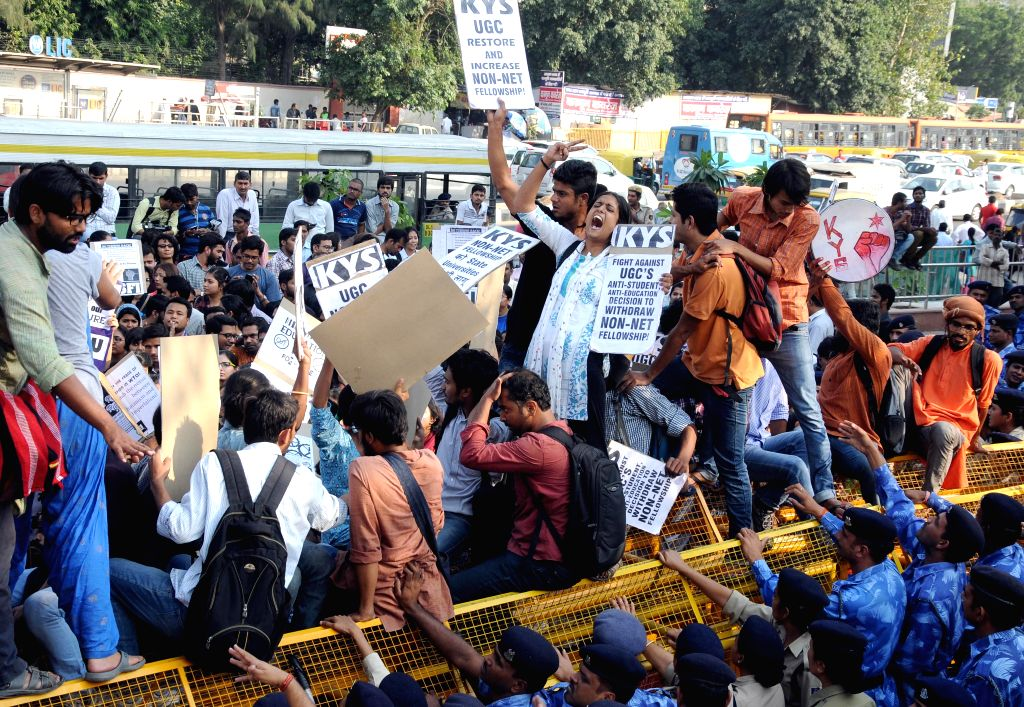Students stage a demonstration outside UGC office in New Delhi, on Oct 26, 2015.