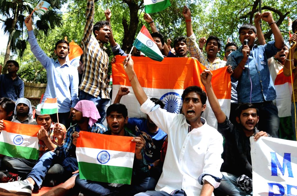 Students stage a demonstration to press for shifting of NIT Srinagar outside Kashmir valley at Jantar Mantar, in New Delhi on April 13, 2016.