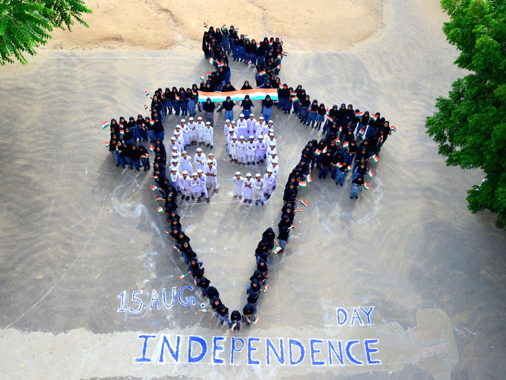 Students stand in the formation of a map of India on the eve of Independence Day in Jodhpur on Aug 14, 2015.