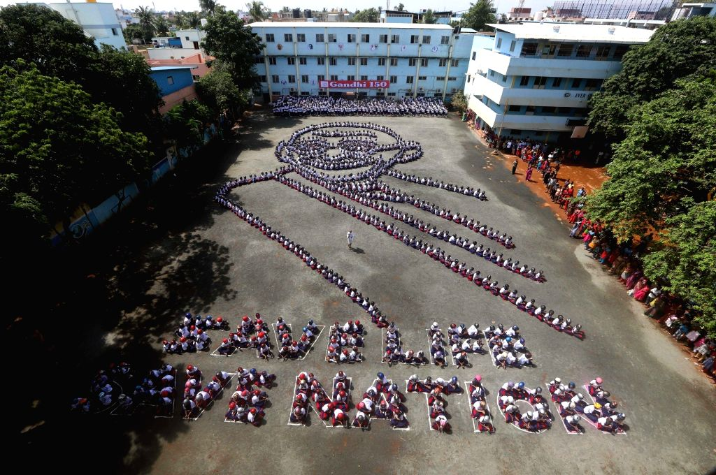 Students stand in the human formation of the face of Mahatma Gandhi during a programme organised ahead of Gandhi Jayanti, in Chennai on Sep 30, 2019.