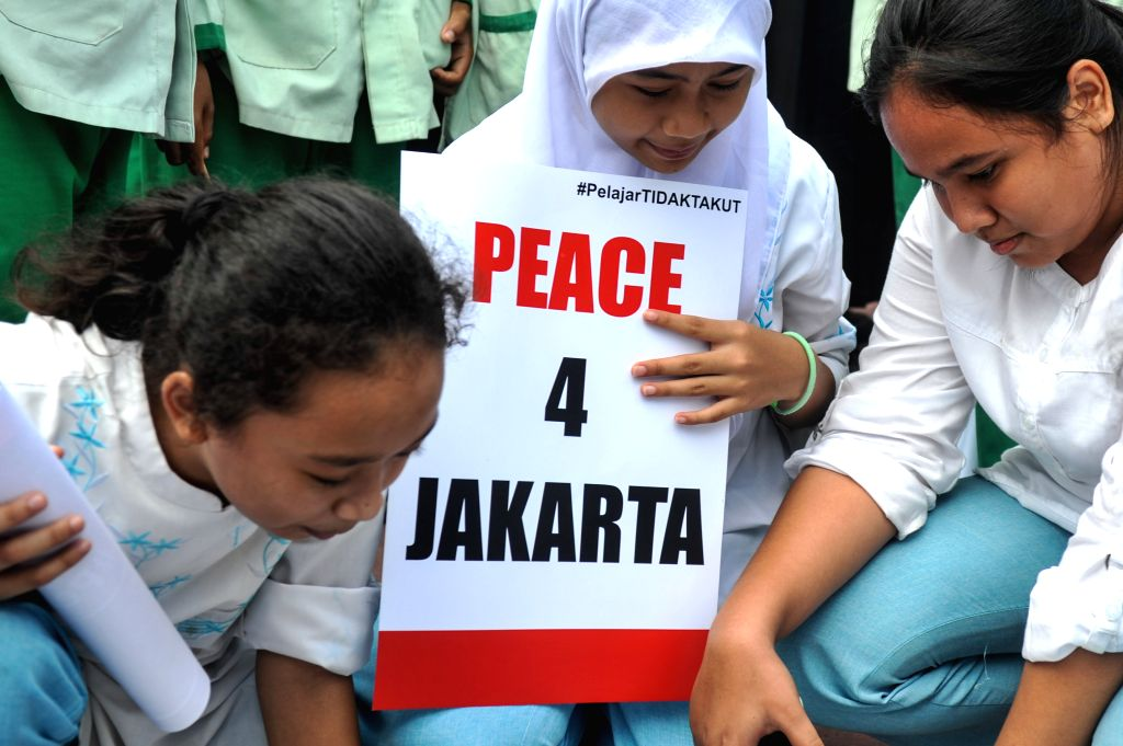 Students take part in a sympathetic action after bomb attacks in Jakarta, Indonesia, Jan. 15, 2016. Explosions and gun fire took place in downtown Jakarta on ...