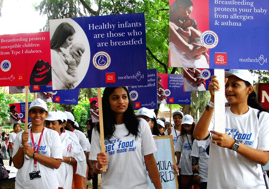 Students take part in breast feeding awareness rally at Mount Carmel College in Bangalore on Aug. 9, 2014.