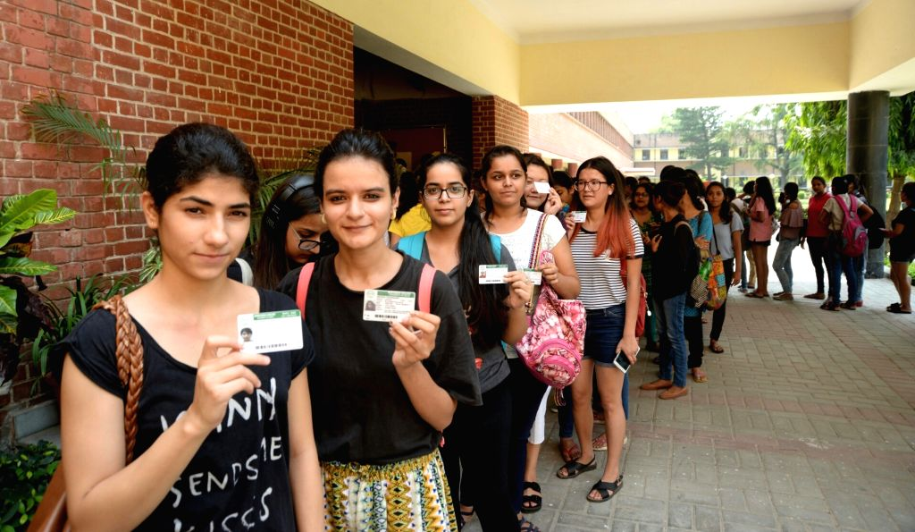 Students wait in a queue to cast their vote during Delhi University elections in New Delhi on Sept 12, 2017.