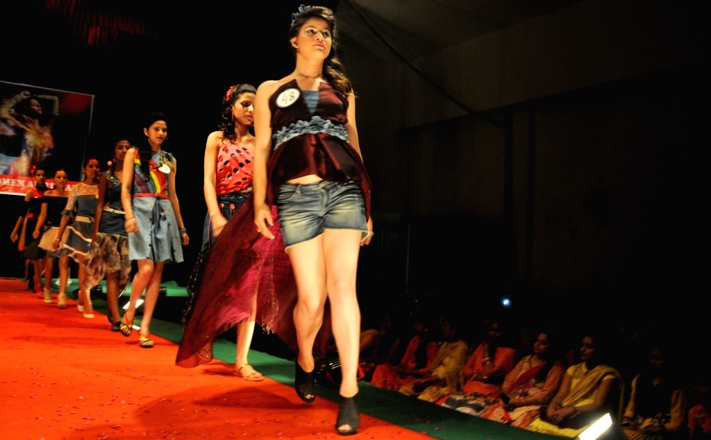 Students walk the ramp during a fashion show organised in a college in Amritsar, on April 9, 2016.