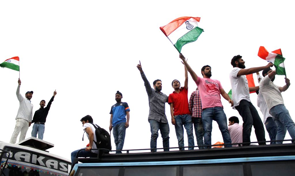Students wave Indian flags in Jammu following a clash between a section of students and police at the Srinagar campus of National Institute of Technology  on April 6, 2016.The campus ...