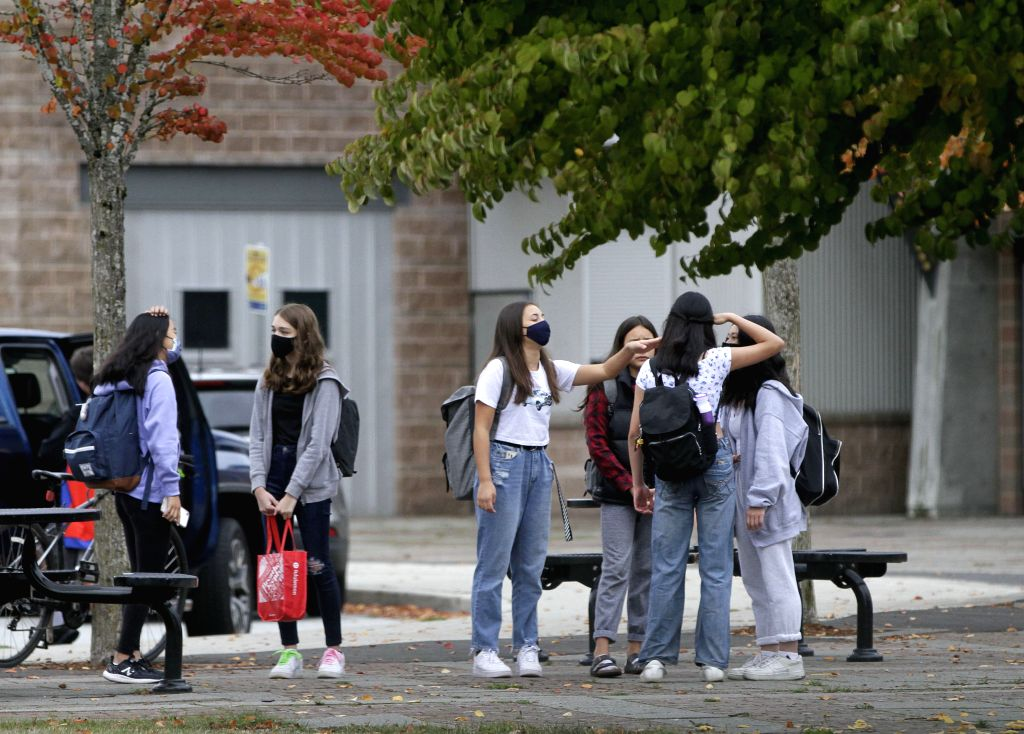 Students wearing face masks are seen at a school in Vancouver, British Columbia, Canada, Sept. 21, 2020. COVID-19 exposures have been reported in at least 20 ...