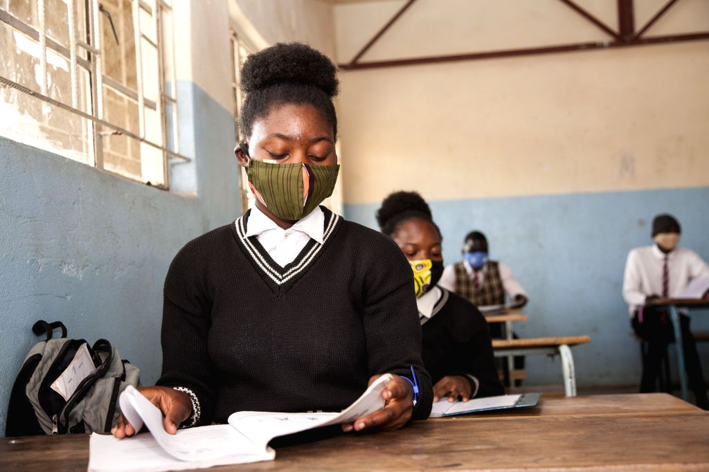 Students wearing face masks attend class at Mejocama Primary and Secondary School in Lusaka, Zambia, Sept. 21, 2020. Zambia National Education Coalition Executive ...