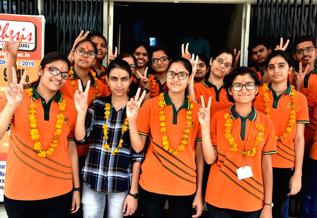 Students who cleared AIIMS MBBS 2019 entrance examination, celebrate in Bikaner on June 13, 2019. The All India Institute of Medical Sciences (AIIMS), New Delhi had declared the results of ...