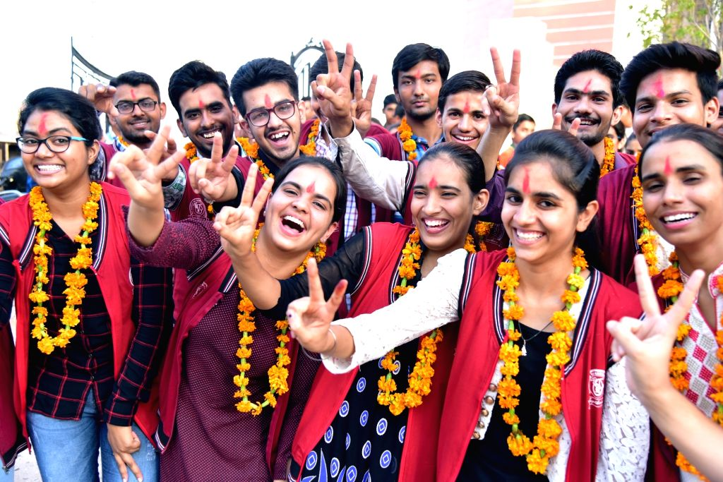 Students who cleared National Eligibility Entrance Test (NEET) for admission to medical and dental courses celebrate in Bikaner on June 23, 2017. As many as 6,11,539 students have qualified ...