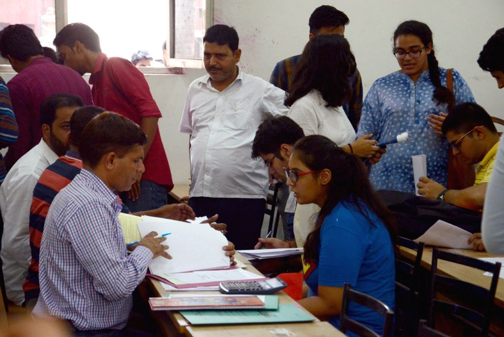 Students who have applied for admissions to various courses of Delhi University check the 1st cut-off list in New Delhi on June 30, 2016.