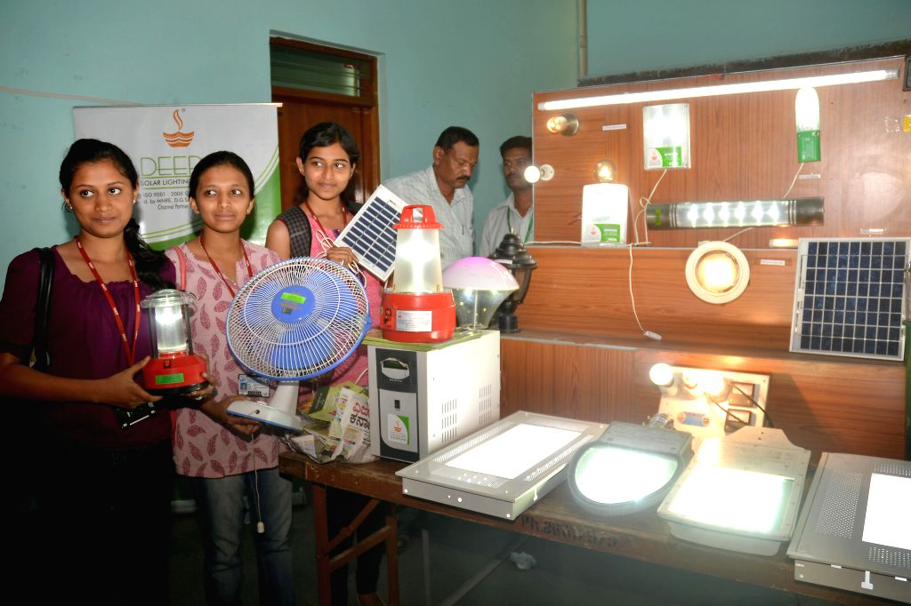 "Students with solar appliances during ""World Earth Day"" celebrations at Jnana Jyothi Auditorium in Bangalore on April 22, 2014."