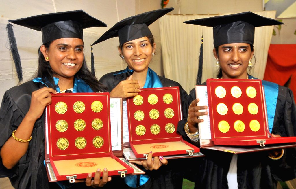 Students with their gold medals during the 48th Convocation of University of Agricultural Sciences, in Bangalore on April 20, 2014.
