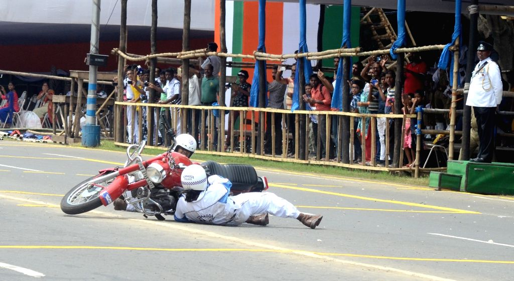 Stunt women from the motorcycle display team of Indian Military's Army Service Corps 'Tornadoes' skid off the bike during rehearsals ahead of Independence Day celebrations, in Kolkata on Aug ...