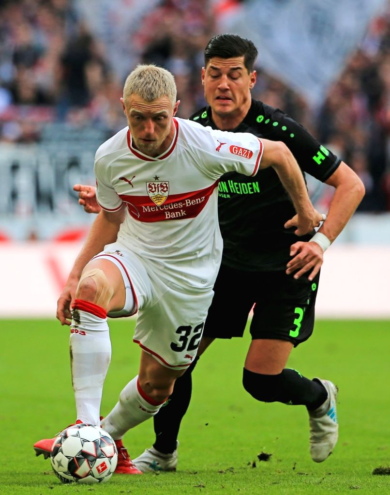 STUTTAGRT, March 4, 2019 - Stuttgart's Andreas Beck (L) controls the ball under the defense from Hanover 96's Miiko Albornoz during a German Bundesliga match between VfB Stuttgart and Hanover 96, in ...