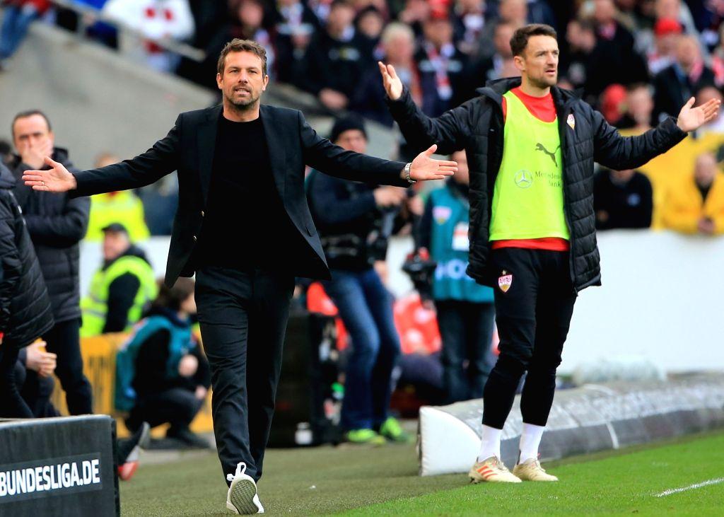 STUTTAGRT, March 4, 2019 - Stuttgart's head coach Markus Weinzierl (L) and player Christian Gentner react during a German Bundesliga match between VfB Stuttgart and Hanover 96, in Stuttagrt, Germany, ...