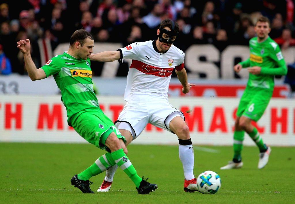 STUTTGART, Feb. 12, 2018 - Stuttgart's Christian Gentner (C) vies with Moenchengladbach's Tony Jantschke (L) during a German Bundesliga soccer match between VfB Stuttgart and Borussia ...