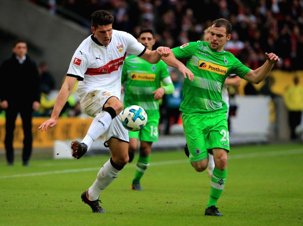 STUTTGART, Feb. 12, 2018 - Stuttgart's Mario Gomez (L) vies with Moenchengladbach's Tony Jantschke during a German Bundesliga soccer match between VfB Stuttgart and Borussia Moenchengladbach in ...