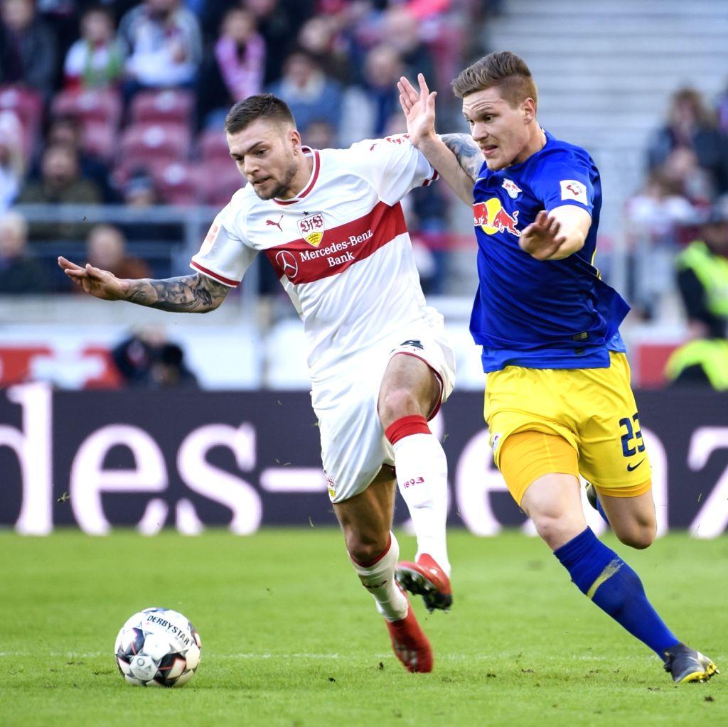 STUTTGART, Feb. 17, 2019 - Leipzig's Marcel Halstenberg (R) vies with Stuttgart's Alexander Esswein during a German Bundeslilga match between VfB Stuttgart and RB Leipzig in Stuttgart, Germany, Feb. ...