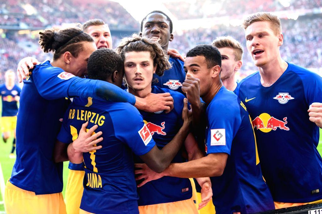 STUTTGART, Feb. 17, 2019 - Leipzig's Marcel Sabitzer (C front) celebrates his scoring with teammates during a German Bundeslilga match between VfB Stuttgart and RB Leipzig in Stuttgart, Germany, Feb. ...