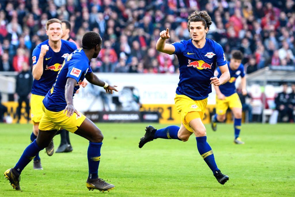 STUTTGART, Feb. 17, 2019 - Leipzig's Marcel Sabitzer (R) celebrates his scoring during a German Bundeslilga match between VfB Stuttgart and RB Leipzig in Stuttgart, Germany, Feb. 16, 2019. Leipzig ...