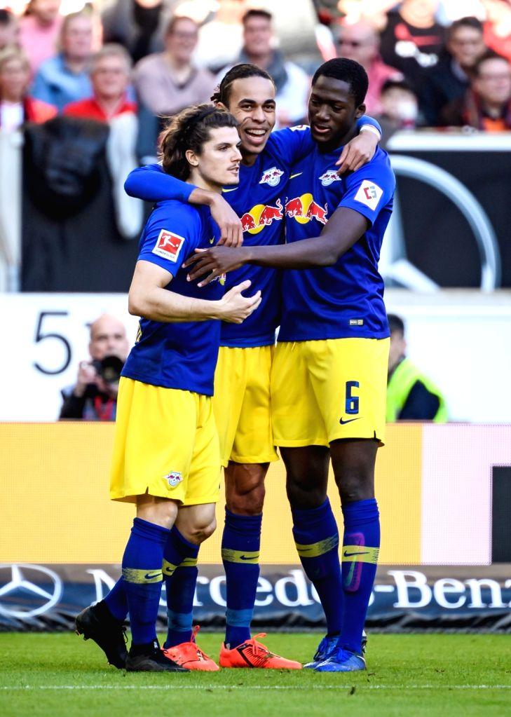 STUTTGART, Feb. 17, 2019 - Leipzig's Yussuf Poulsen (C) celebrates scoring with Marcel Sabitzer (L) and Ibrahima Konate during a German Bundeslilga match between VfB Stuttgart and RB Leipzig in ...