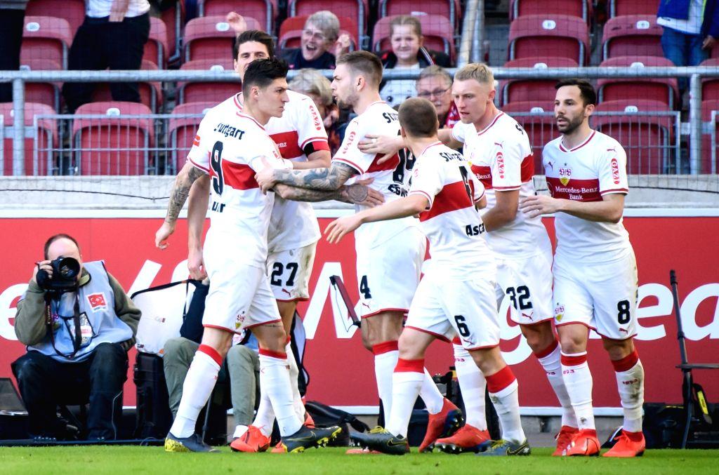 STUTTGART, Feb. 17, 2019 - Stuttgart's Steven Zuber (2nd L) celebrates his scoring with teammates during a German Bundeslilga match between VfB Stuttgart and RB Leipzig in Stuttgart, Germany, Feb. ...