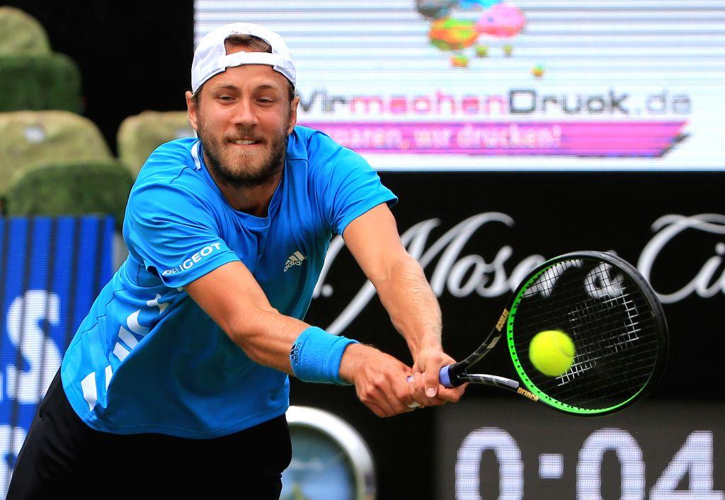 STUTTGART, June 14, 2019 - Lucas Pouille of France returns a shot during the men's singles quarterfinal match of ATP Mercedes Cup tennis tournament against Jan-Lennard Struff of Germany in Stuttgart, ...
