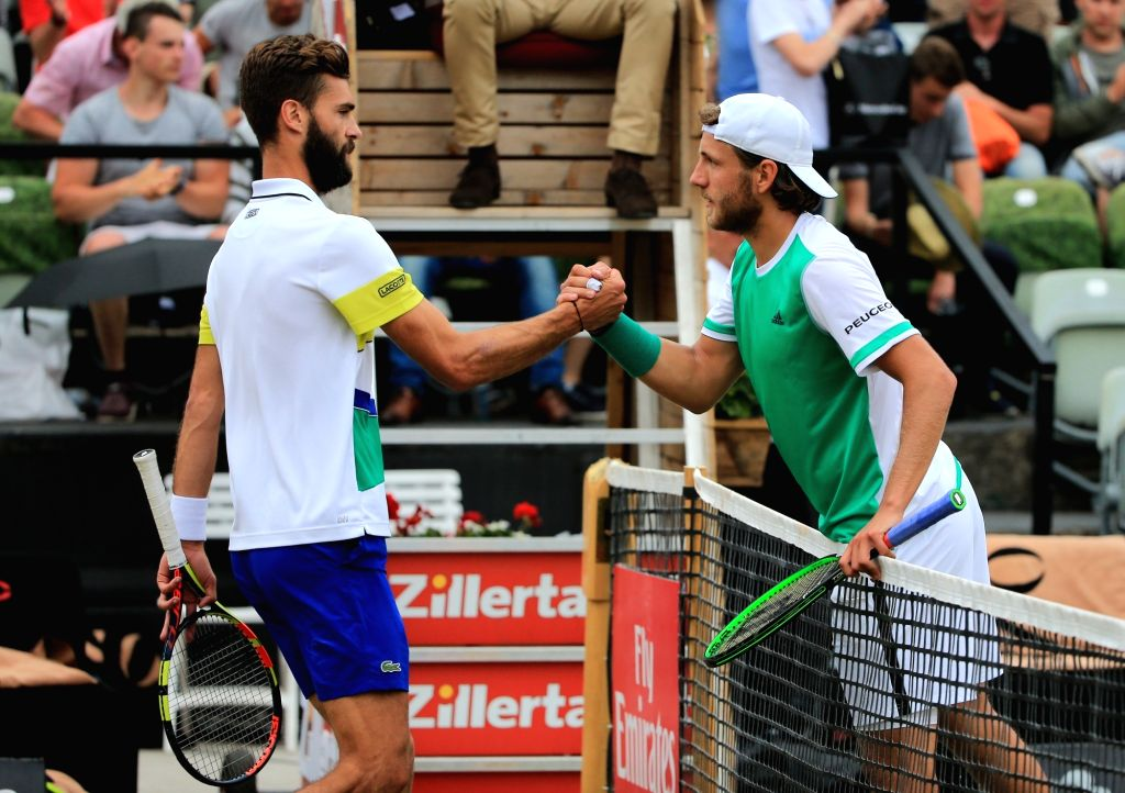STUTTGART, June 18, 2017 - France's Lucas Pouille (R) shakes hands with his countryman Benoit Paire after a semi-final match of Mercedes Cup tennis tournament in Stuttgart, Germany, on June 17, 2017. ...