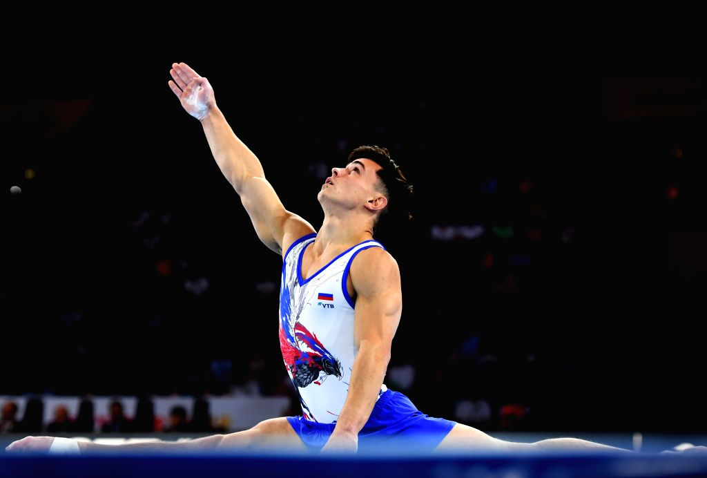 STUTTGART, Oct. 10, 2019 - Artur Dalaloyan of Russia competes on the floor during the Men's Team Final of the 2019 FIG Artistic Gymnastics World Championships in Stuttgart, Germany, Oct. 9, 2019.