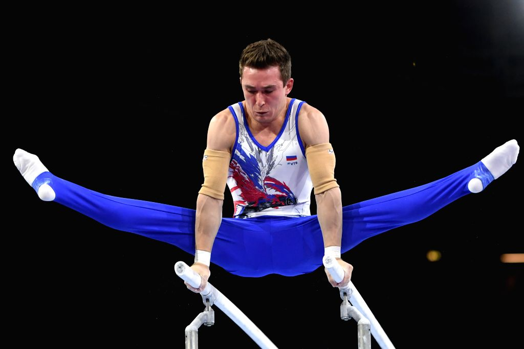 STUTTGART, Oct. 10, 2019 - David Belyavskiy of Russia competes on the parallel bars during the Men's Team Final of the 2019 FIG Artistic Gymnastics World Championships in Stuttgart, Germany, Oct. 9, ...