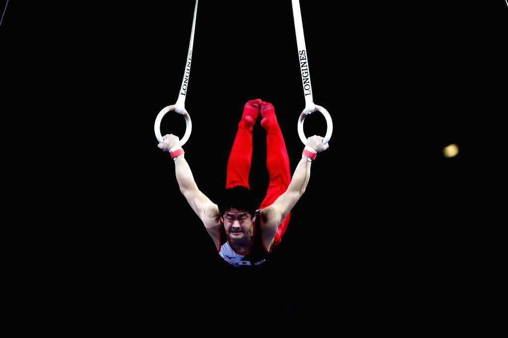 STUTTGART, Oct. 10, 2019 - Kamato Yuya of Japan competes on the rings during the Men's Team Final of the 2019 FIG Artistic Gymnastics World Championships in Stuttgart, Germany, Oct. 9, 2019.