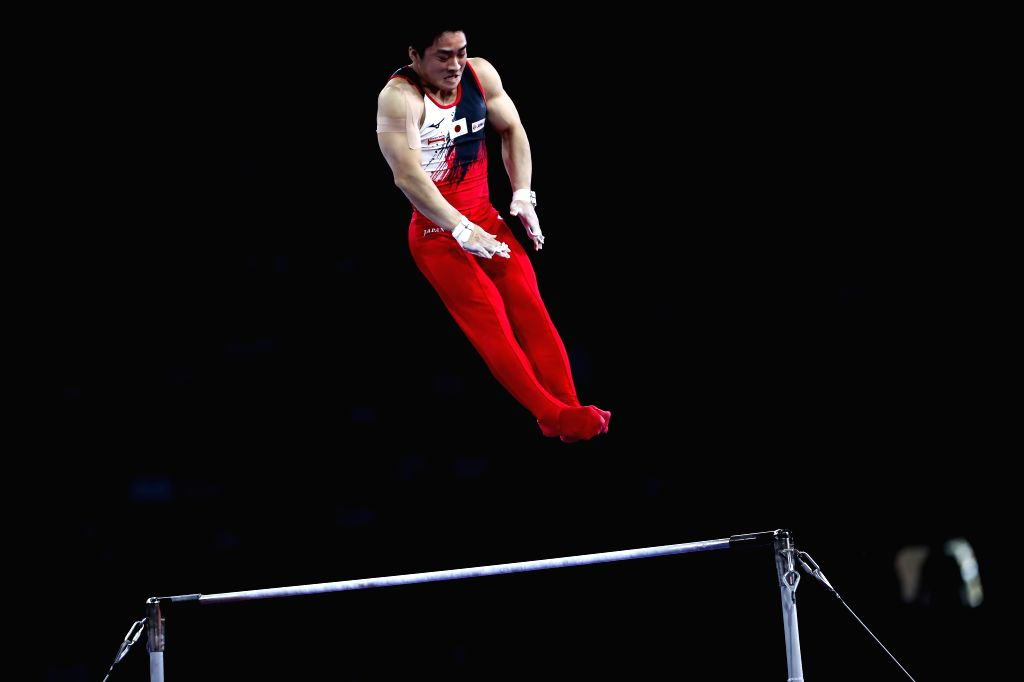STUTTGART, Oct. 10, 2019 - Kamato Yuya of Japan competes on the horizontal bar during the Men's Team Final of the 2019 FIG Artistic Gymnastics World Championships in Stuttgart, Germany, Oct. 9, 2019.