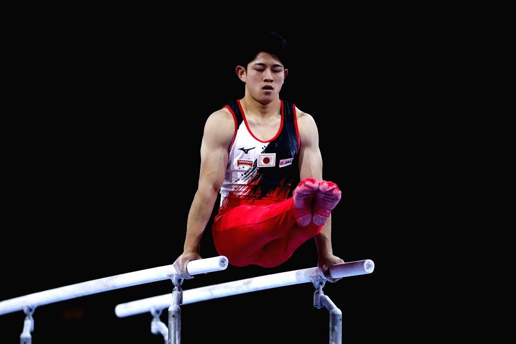 STUTTGART, Oct. 10, 2019 - Tanigawa Kakeru of Japan competes on the parallel bars during the Men's Team Final of the 2019 FIG Artistic Gymnastics World Championships in Stuttgart, Germany, Oct. 9, ...