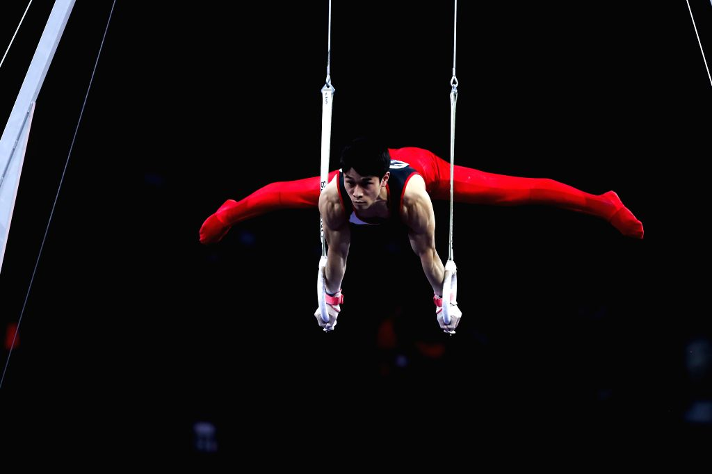 STUTTGART, Oct. 10, 2019 - Tanigawa Wataru of Japan competes on the rings during the Men's Team Final of the 2019 FIG Artistic Gymnastics World Championships in Stuttgart, Germany, Oct. 9, 2019.