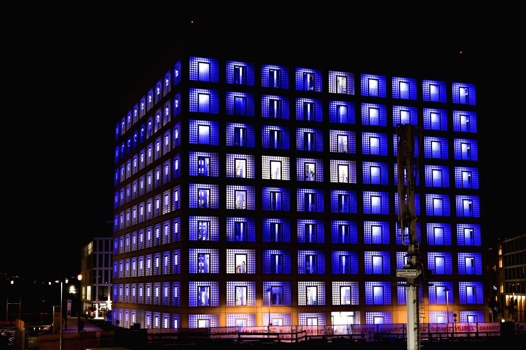 STUTTGART, Oct. 8, 2019 - Photo taken on Oct. 7, 2019 shows the night view of the Stuttgart Municipal Library in Stuttgart, Germany. Opening in 2011, the Stuttgart Municipal Library has become the ...