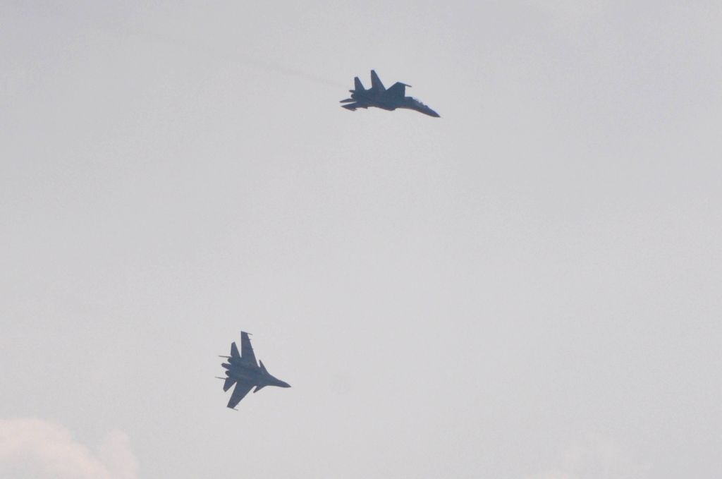 Su-30 MKI air superiority fighter aircrafts participate in a flypast after taking off from the Netaji Subhash Chandra Bose International Airport during an IAF exercise carried out to ...