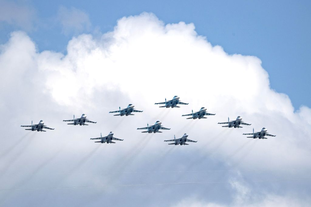 Su-35S, Su-34 and Su-30SM jet fighters fly over the Red Square during the military parade marking the 75th anniversary of the victory in the Great Patriotic War in ...