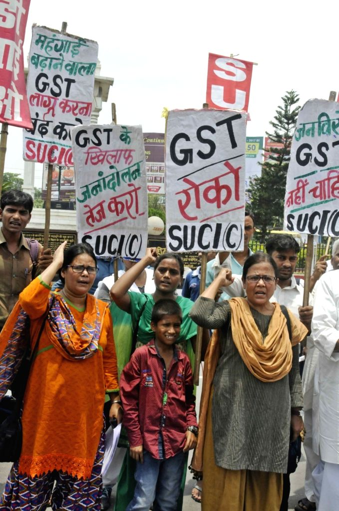 SUCI activists stage a demonstration against GST in Patna on June 30, 2017.